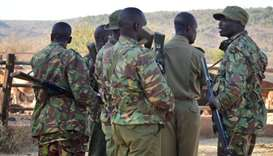 Kenya police officers gather near the site