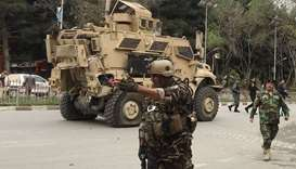 US military vehicle is seen at the site of a suicide bomb attack