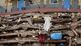 The ruins of seven-storey building is pictured on June 13, 2017 after it collapsed overnight in the