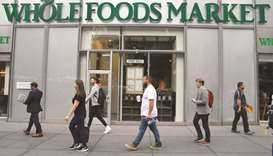 Amazon to buy Whole Foods in $13.7bn bet on groceries