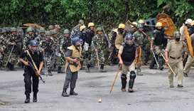 Indian CRPF personnel walk during clashes in Darjeeling