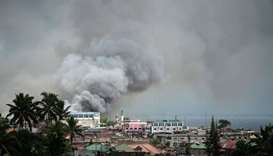 Smoke rises after aerial bombings by Philippine Air Force planes on militant positions in Marawi
