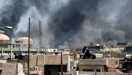 Smoke caused by clashes between the Iraqi forces and Islamic State militants is seen in Mosul
