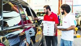 Ooredoo distributes Iftar boxes at Umm Ghuwailina petrol station