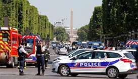 Car ploughs into police van in Champs-Elysees 'attack'