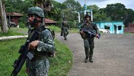 Philippine Marines patrol a walkway after engaging with militants in Marawi