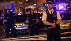 Police guard a street in the Finsbury Park area of north London where a vehicle hit pedestrians