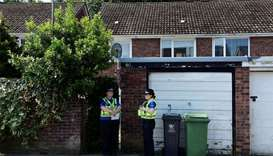 Police officers stand outside the home of Darren Osborne, in Cardiff