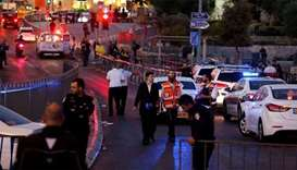 Israeli policemen secure the scene of the shooting and stabbing attack outside Damascus gate in Jeru