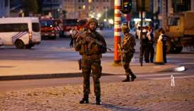 Belgian troops take up position following an explosion at the Central Station in Brussels.