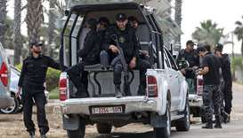 Palestinian security forces stand guard at the border as trucks carrying fuel enter the Gaza Strip f