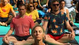 Yoga practitioners search for serenity in Times Square