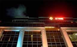 Smoke comes out of the roof of the Resorts World Hotel in Manila following an attack
