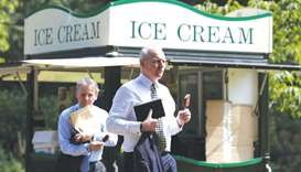 Two men buy ice cream in St James's Park in central London yesterday as temperatures across the coun