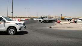 A light truck (centre) making an illegal U-turn at a roundabout in the Doha Industrial Area. PICTURE