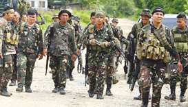 Philippine soldiers patrol a road at Pigcawayan, a farming town about 160 kilometres from Marawi cit
