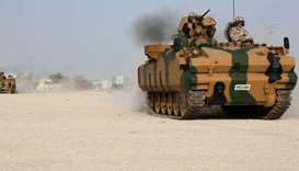 Turkish APC drives at their military base in Doha, Qatar.  June 18, 2017 file picture