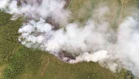 A picture taken yesterday in Liessel shows an aerial view of the fire at Deurnese Peel National Park