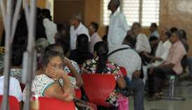 Sri Lankan patients wait for treatment at an empty government hospital in Colombo