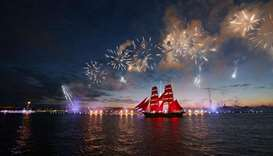 Fireworks explode over Sweden's brig Tre Kronor with scarlet sails which floats on the Neva River