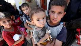 Displaced Iraqi children who fled from clashes are seen in the Old City of Mosul