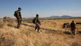 Israeli soldiers patrol near the border with Syria after projectiles fired from the war-torn country