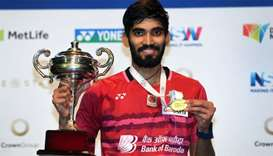 Kidambi Srikanth of India poses with the winner's trophy in the Australian Open men's singles badmin