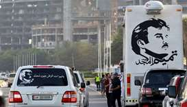 A painting depicting Qatar's Emir is seen on a bus during a demonstration in support of him in Doha