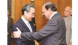 Pakistan President Mamnoon Hussain shakes hands with Chinese Foreign Minister Wang Yi upon his arriv