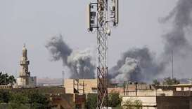 Smoke billows after an air strike by Iraqi forces towards Islamic State militants in the Old City of