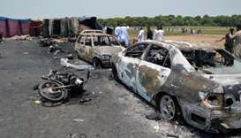 Burnt out cars and motorcycles are seen at the scene of an oil tanker explosion in Bahawalpur, Pakis