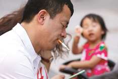 Despite the world's huffing, China's smokers keep on puffing