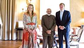 Queen Maxima and King Willem Alexander of the Netherlands pose for a photograph with Prime Minister