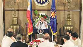 President Rodrigo Duterte gestures as he addresses Filipino-Muslim leaders during an Eid al-Fitr cel