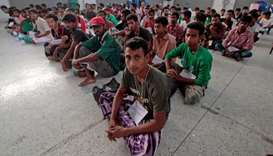 Suspected Rohingya migrants from Myanmar and Bangladesh rest at Rattaphum district hall in Thailand'