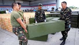Government soldiers unload crates of firearms, provided through China's urgent military assistance