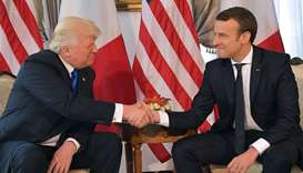US President Donald Trump (L) and French President Emmanuel Macron
