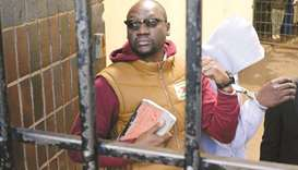 Handcuffed Pastor Evan Mawarire arrives at court in Harare yesterday.