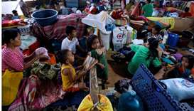 Evacuated residents rest at an evacuation centre in Iligan