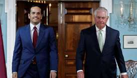 Foreign Minister HE Sheikh Mohammed bin Abdulrahman Al-Thani (L) walks with US Secretary of State Re