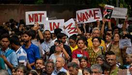 Indian protesters holding placards as they gather during a 'Not in my name' silent protest at Jantar