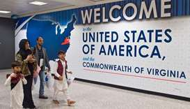 US rolls out travel ban, but who will be hit?