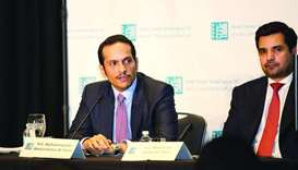 HE the Foreign Minister Sheikh Mohamed bin Abdulrahman al-Thani, left, attending a gathering hosted