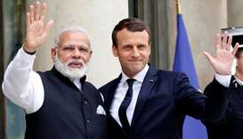 Indian Prime Minister Narendra Modi is greeted by French President Emmanuel Macron