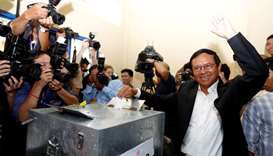 President of the opposition Cambodia National Rescue Party (CNRP) Kem Sokha casts his vote