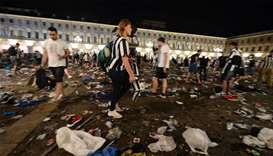 Juventus supporters look for personal belongings at Piazza San Carlo after the panic movement