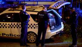 Police are pictured in the Melbourne bayside suburb of Brighton