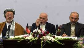 Afghan President Ashraf Ghani (C) delivers his speech at an international peace conference in Kabul