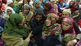 The mother (centre R) of Indian Kashimiri college student Adil Farooq Magray cries during Adil's fun