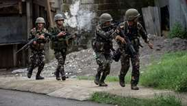Philippine Army Scout Rangers move positions during a mission  in Marawi